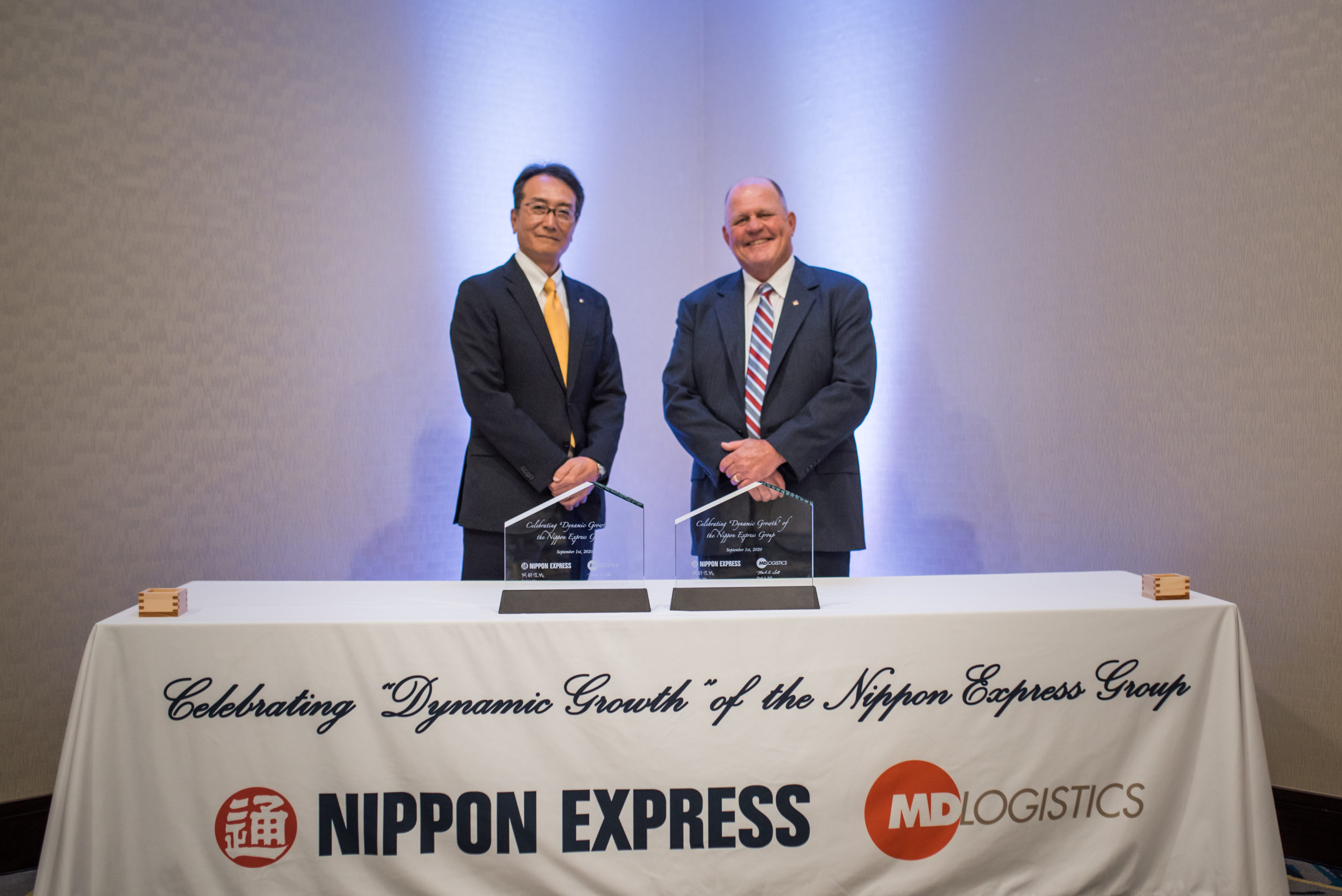 executives from Nippon Express and MD Logistics